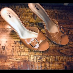 Fioni tan mules with gold buckle size 12